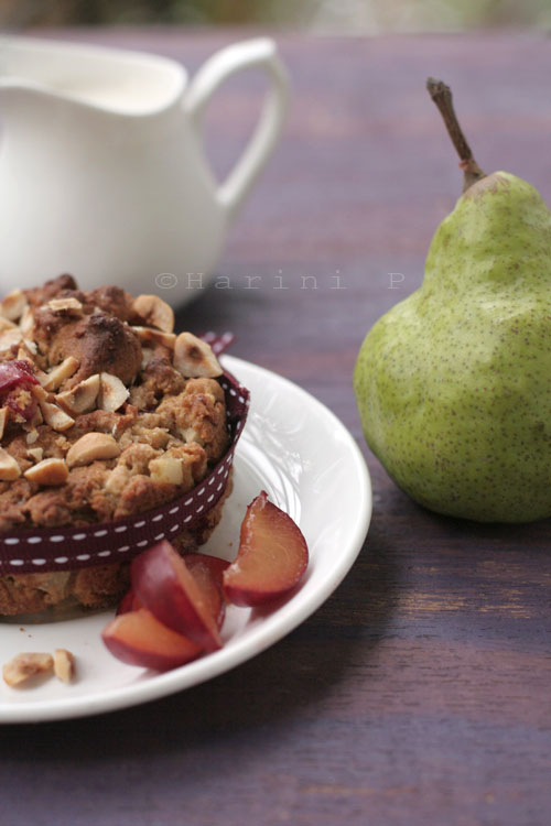 Pear and plum cake with hazelnuts