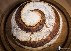 Spiral Rye Boule (noobographer) Tags: wood food brown crust bread spiral baking pattern wheat board traditional rye crack delicious whole bakery cutting loaf flour artisan scoring crumb baked scored