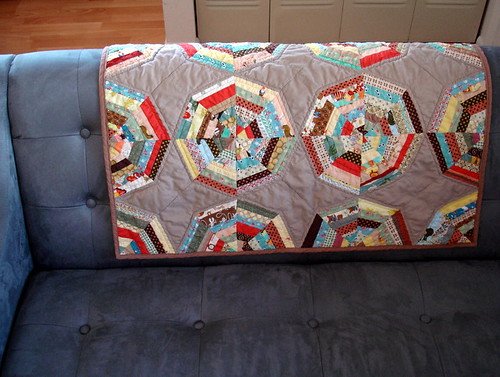 spiderweb quilt on couch