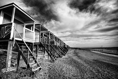 Beach huts at Thorpe Bay, Essex (louisahennessysuou) Tags: blackandwhite monochrome thames geotagged mono estuary explore essex beachhuts southend sigma1020mm flickrexplore thorpebay explored flickrsfinest artistictreasurechest geo:lat=51528637 geo:lon=0756115