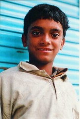 The prince of the streets (N A Y E E M) Tags: boy young beggar ronnie bangladesh gec chittagong fujicolorsuperia leicar9 summiluxr80mm flickaward nayeemkalam