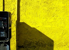 Phone Yellow (See El Photo) Tags: shadow urban 15fav favorite color colour lines yellow wall outside colorful colore phone telephone payphone 100views fav farbe couleur publicphone 1f faved 色 顏色 цвет 색깔 χρώμα