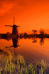 Kinderdijk Sunset (Philipp Klinger Photography) Tags: sunset sky orange cloud holland color reflection tree green mill water netherlands windmill grass easter happy spring nikon colorful europe searchthebest wind nederland filter colourful nl topf150 philipp paysbas spiegelung soe kinderdijk oranje molens zuidholland ridderkerk cokin klinger moulins alblasserdam nieuwlekkerland mywinners abigfave anawesomeshot d700 overtheexcellence dcdead vanagram