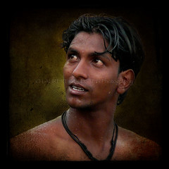 With his Eyes Open (designldg) Tags: portrait people india man male eye water closeup youth expression handsome atmosphere panasonic varanasi nudity chiaroscuro ganga ganges ghats benaras clairobscur uttarpradesh  indiasong dmcfz18 hourofthesoul