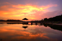 Double that burning sky (J.^2) Tags: sunset red sky orange cloud reflection water silhouette rock canon singapore dusk burning pavilion j2 jiangjiang 50d lowerpiercereservoir jsquare