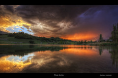 Pluie de feu (Girolamo's HDR photos) Tags: light sunset sky sunlight lake storm france tree nature rain clouds canon reflections french landscape fire photography gold spring savoie hdr cumulonimbus rhnealpes girolamo photomatix tonemapping canoneos50d lacsaintandr cracchiolo omalorig wwwomalorigcom gettyimagesfranceq2