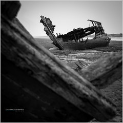 fleetwood_shipwreck-9 (D_M_J) Tags: white seascape black abandoned river landscape boats coast xpro fuji lancashire shipwreck marsh fleetwood wyre fylde
