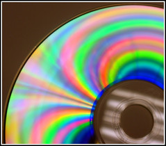 55/365 CD Rainbow (pbiggs42) Tags: pink blue light orange abstract color colour reflection green closeup reflections rainbow cd refraction project365 t189project365