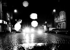street bokeh (Daniel*1977) Tags: road street city light urban blackandwhite bw white black love wet monochrome car rain night work dark myself stars grey town photo walks flickr place bokeh terrace dusk district gray captured picture shapes samsung center move diamond neighborhood mob story government civic borough around highkey did avenue lowkey section dull province environs proximity drab blackdiamond precinct municipality poznan vicinity ashen pro815 samsungpro815 flickrsbest 1950s kuliski urbanshapes didmyself tzf20 gettypoland1