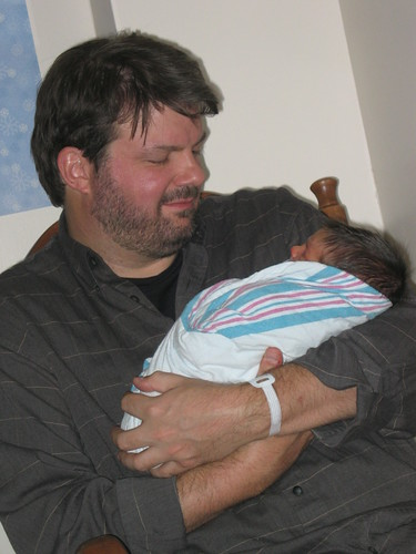Daddy holds his 2-day-old son Finn