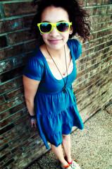 blue portrait sun brick girl smile sunglasses yellow wall lens glasses nikon dress d 200 mm nikkor 18 90 2009 vr 18200mm d90 f3556g nikor