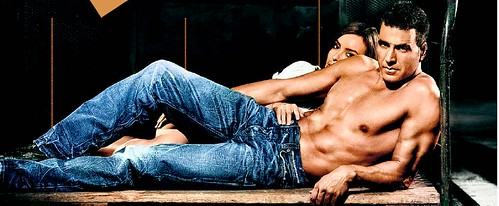 Akshay Kumar with a female model in jeans and bare torso