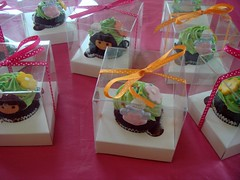 Dora cupcakes in boxes (LoveBones) Tags: pink orange green boots box chocolate dora cupcake vanilla ribbon