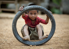 Hmong kid in North Laos (Eric Lafforgue) Tags: poverty voyage travel game tourism kid asia child play wheels asie laos lao asean hmong tourisme jeu roue mong  pauvrete lafforgue laopeoplesdemocraticrepublic lpdr   asiedusudest socialistrepublic laosa    laosz  frenchcolonialempire rpubliquedmocratiquepopulairelao  laosas