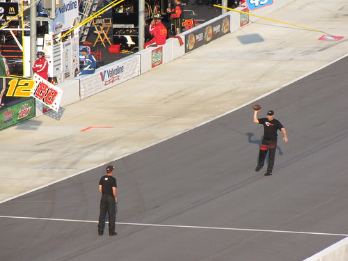 Crew members tossing a football before the race