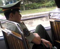 Sleeping guard on a bus, China (Beijing Patrol) Tags: sleeping hat uniform board guard police cap  shoulder officer visor paramilitary    peaked  capf epaulet
