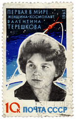 Tereshkova's face in black and white on a blue and white stamp with Russian writing