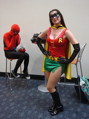 (okay, I'm really confused by this one) Spider-Girl talking on her cell while holding a Tribble... and Robin the Boy Wonder if he were an adult woman (Pop Culture Geek) Tags: sanfrancisco costumes robin fans 2009 tribble wondercon spidergirl