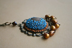 forget-me-not pendant side view (Chili Crab) Tags: flowers blue brown bronze gold one chili crystal ooak crab jewelry kind fimo clay pearl etsy brass 2009 pendant freshwater filigree polymer swarovsky