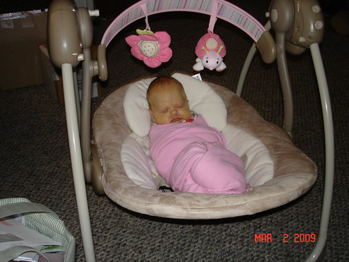 sleeping in her new swing