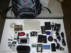 What's In Your Bag?.....My Swiss Gear Bag & its gadgets. (bigraz818) Tags: moleskine psp nokia coach ipod swiss sony flip acer whatsinyourbag whatsinmybag ultra inmybag maximo wiyb n800 letherman flipultra aspireone polaroidi1035