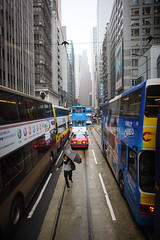 Frogger (briyen) Tags: street city people urban bus rain point hongkong wind photos taxi tram run hong kong streetphoto hop tight  vanishing frogger flickrchallengegroup flickrchallengewinner