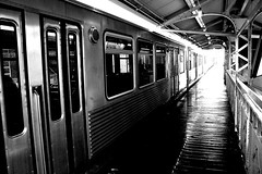 wet platform and el train (John J Curtis) Tags: wickerpark chicago cta eltrain damen chicagoel chicagotrain elplatorm johnjcurtis