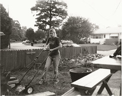 Mowing (James B Currie) Tags: street people bw girl grass fence photographyclass lawn jeans 1998 90s mowing lawnmover aragona