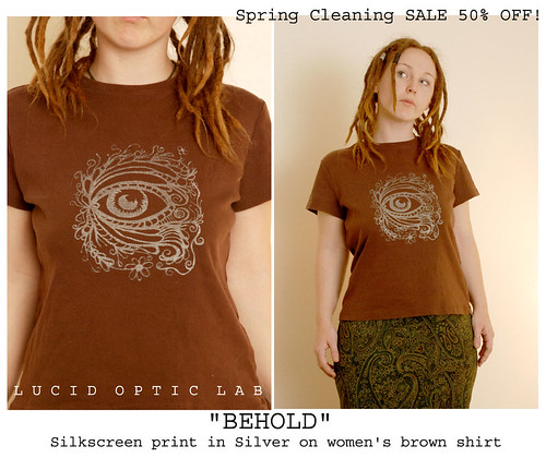 Behold silkscreen print in silver on brown women's tee