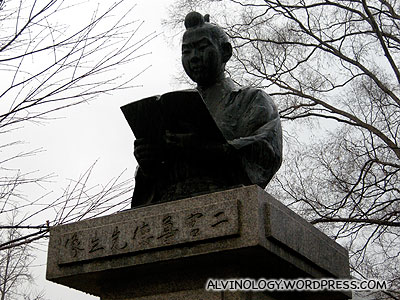 A statue seen outside a library