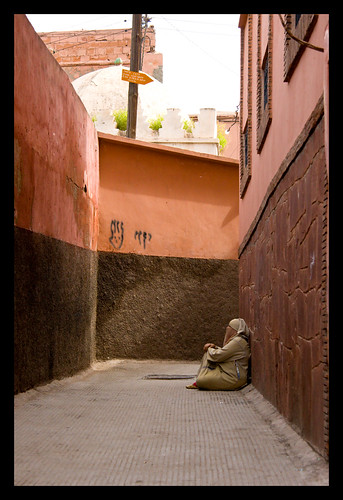 woman begging in the medina of Marrakech