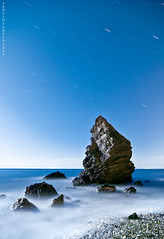Rock sings to the moon (SergioTudela) Tags: longexposure sea beach water sergio rock stone stars star mar andaluca agua nikon rocks nightshot stones tokina1224 playa tokina estrellas nocturna estrella roca rocas mlaga piedras maro piedra largaexposicin d80 mywinners nikond80 platinumphoto theunforgettablepictures overtheexcellence ostrellina sergiotudela sergiotrnet