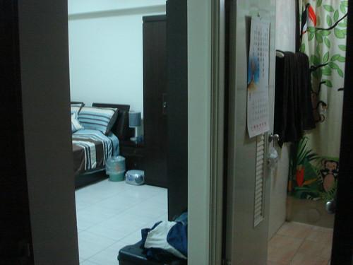 Doorway to bedroom with bathroom visible