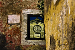 """El paso del tiempo"" (Vincent Luigi Molino) Tags: red building clock church colors yellow time viterbo pity piet calcata flickrlovers fabbow platinumpeaceaward vincentluigimolino pitystreet"