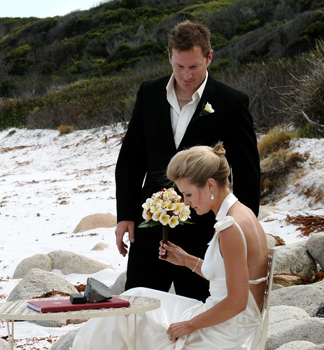 A lovely beach wedding the bride with a striking and elegant updo