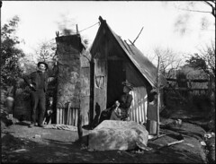 A man and woman outside a bush hut (Powerhouse Museum Collection) Tags: poverty chimney blackandwhite bw woman dog house man dogs hat carpet couple bricks poor pipe australia hut hoe shanty horseshoe pioneer retouched corrugatediron aframe powerhousemuseum pressedtin handtools leanto bushhut xmlns:dc=httppurlorgdcelements11 arthurphillips wunderlichlimited dc:identifier=httpwwwpowerhousemuseumcomcollectiondatabaseirn385886 wunderlichpanels commons:event=commonground2009