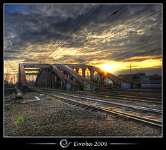 Sunset @ Vierendeelbrug, Mechelen, Belgium :: HDR :: Vertorama (Erroba) Tags: sunset electric clouds photoshop canon rebel grafitti belgium belgique tripod belgi sigma trains wires tips rails joker remote 1020mm erlend hdr mechelen cs3 3xp photomatix tonemapped tonemapping vierendeelbrug spoorwegbrug xti 400d vertorama erroba robaye erlendrobaye