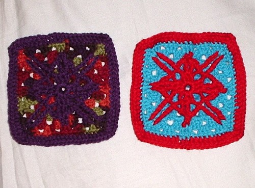Two completed potholders