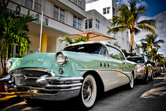 Classic Buick (roevin | Urban Capture) Tags: street city trees shadow urban usa tree classic cars beach car buick florida miami unitedstatesofamerica palm getty oldtimer artdeco miamibeach buldings valet oceandrive collinsavenue theperfectphotographer