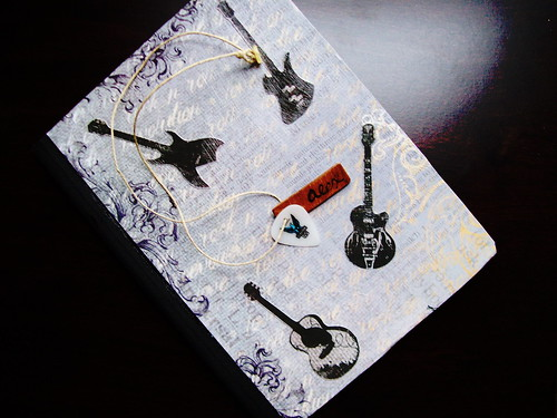 Necklace on Guitar Notebook