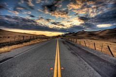 It's all downhill from here (Chris Delle) Tags: california road sunset lines clouds canon landscape vanishingpoint pavement scenic hills 1020 hdr sutterbuttes sigma1020mm 40d