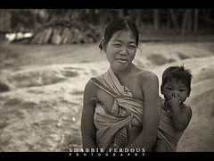 Bangladesh : Mro Mother & Child (Shabbir Ferdous) Tags: portrait bw smile sepia blackwhite photographer child shot mother tribe bangladesh mro bangladeshi canoneos5d ef70200mmf28lisusm tribalwoman bandarbans tribalclothes shabbirferdous chittagonghilltracks wwwshabbirferdouscom shabbirferdouscom