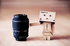 Danbo and Sigma (Weidotcom) Tags: anime macro lens toy amazon nikon dof bokeh manga magenta 85mm plastic mount figurine tones f28 105mm danbo 85mmf18 sigma105mm revoltech d700 danboard