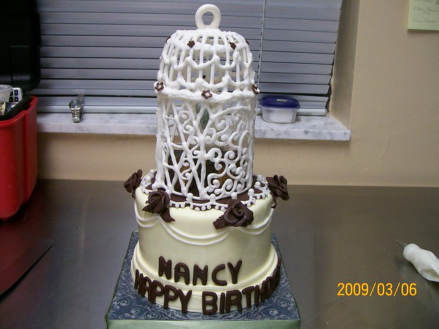 Bird cage cake. Happy Birthday Nancy, your bird is inside.