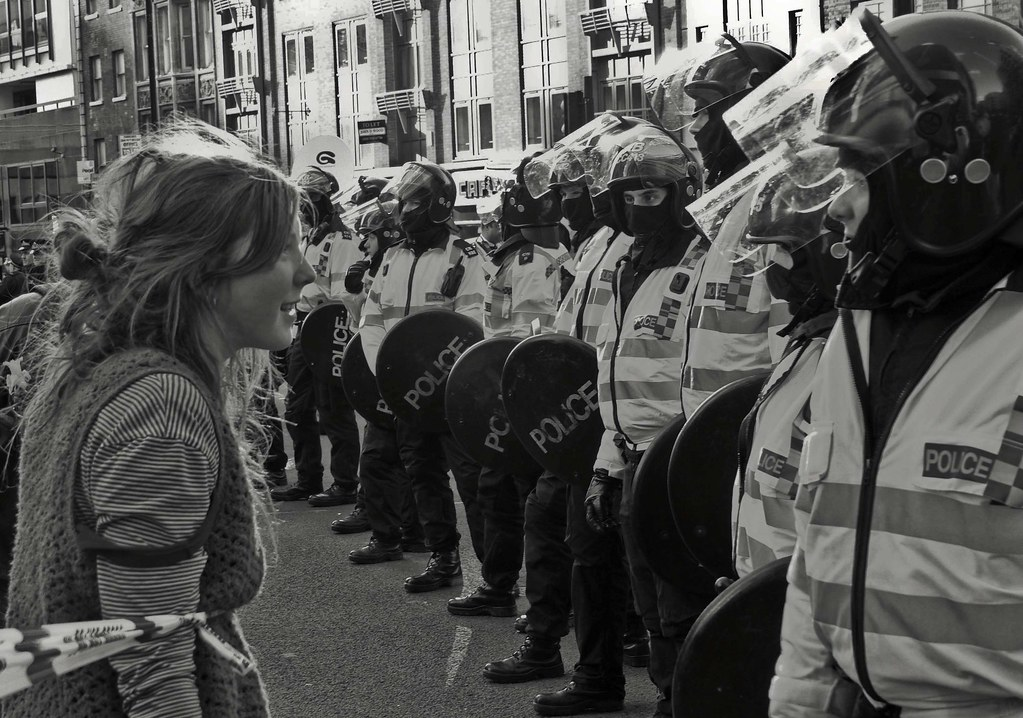 British riot police confront 'dangerous' protestor