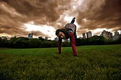 kubi-parkta (mrkubi) Tags: park people usa playing ny newyork man building tree grass america dark high jump nikon play cloudy centralpark manhattan central enjoy kuni maymun d90 kubilay nikond90 mrkubi kubilayozvardar
