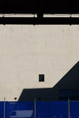NYC Window & Shadow (Larry Newquist) Tags: shadow window blue bridge wall windows urban nyc newyorkcity manhattan lines graphic city construction building abstract cement contrast line