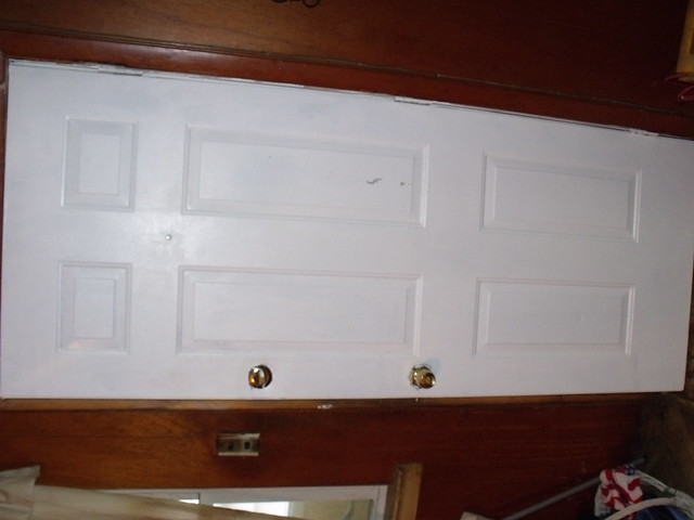 A new front door was installed for a local community member as part of Smithfield Packing's Christmas in April program