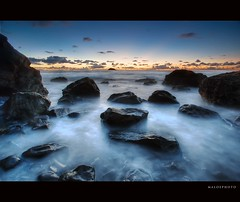 Maori Bay Misty Water (Mark Emirali) Tags: longexposure sunset newzealand seascape landscape rocks exposure nz westcoast 1022mm 30d copyrighted canon30d maoribay pleasedonotusewithoutmypermission maloe4 maloephoto maloephotography markemirali markemiraliphotography