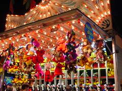 Erie County Fair, 2001...midway games (Guenther Lutz) Tags: colors buffalo arcade impact amusementpark newyorkstate prizes eriecountyfair